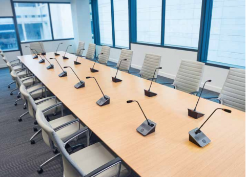 ATUC-50 Digital Discussion System displayed in board room setting
